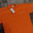 Отдается в дар Поло унисекс, цвет ярко оранжевый, 48 размер.