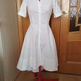 Отдается в дар Новое белое джинсовое платье Bizzarro 42 размер
