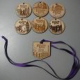 Отдается в дар Деревянные медали Бегущий город