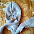 Отдается в дар Шапка вместе с шарфом.