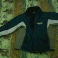 Отдается в дар зимняя курточка на 5-7 лет.