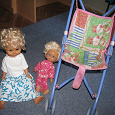 Отдается в дар игрушечная коляска и две куклы