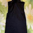 Отдается в дар Черная водолазка без рукавов, 40-42 размер