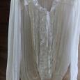 Отдается в дар красивая белая блузка р.48-52