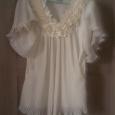 Отдается в дар элегантная блуза 46-48 или L