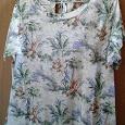 Отдается в дар Летняя трикотажная футболка, на размер 46-48, с тропическими растениями, в отличном состоянии.