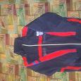 Отдается в дар Спортивная утепленная куртка 134-140