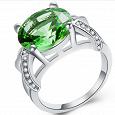 Отдается в дар Серебряное кольцо 925 пр., с зел. лаб.Топазом. 23 размер