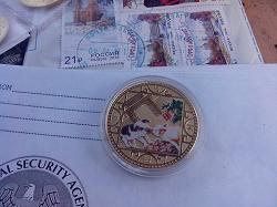 Отдается в дар «Монетовидный жетонМонетой год свинки»