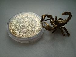 Отдается в дар «Сувенирная позолоченная монета.»