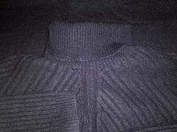 Отдается в дар «удлиненный свитерок 42р»