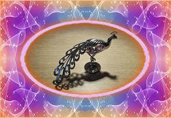 Отдается в дар «Сувенир Жар птица с кристаллами Swarovski»