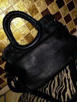 Отдается в дар «Чёрная кожаная сумка»