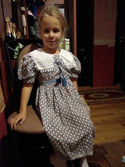 Отдается в дар «платья на 122-128»