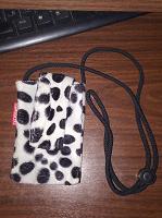 Отдается в дар Меховая сумочка для телефона