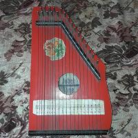 Отдается в дар Детский музыкальный струнный инструмент