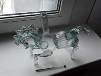 Отдается в дар Коллекционная бутылка в виде коня.