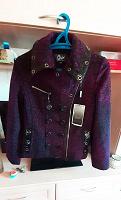 Отдается в дар новая демисезонная курточка 48-50 размер