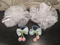 Отдается в дар Куча резинок (бантики, цветочки, мишки) и ободок.