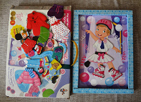 Отдается в дар Кукла магнитная с набором одежды