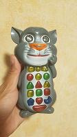 Отдается в дар Музыкальная игрушка Том «Умный телефон-кот»