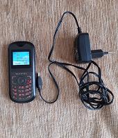 Отдается в дар телефон Alcatel с зарядным устройством