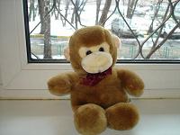 Отдается в дар Мягкая игрушка-обезьянка. поет.