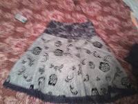 Отдается в дар юбка р-р 44 новая.тёплая, отделка кружево
