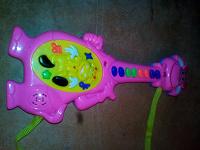 Отдается в дар Музыкальная игрушка гитара