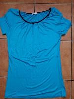 Отдается в дар женская футболка 48 р.