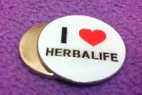 Отдается в дар значок «Herbalife»
