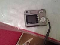 Отдается в дар фотоаппарат цифровой но старый на батарейках 2-х