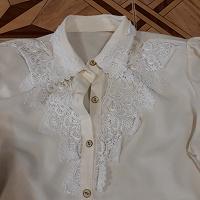Отдается в дар блузка 50-52 р-р