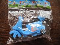 Отдается в дар новая игрушка -мотоцикл