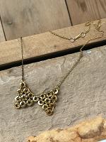 Отдается в дар Ожерелье с бантиком из гаек