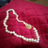 Отдается в дар Жемчужное ожерелье.