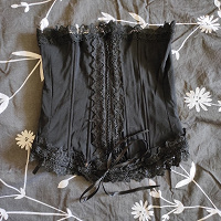 Отдается в дар Корсет черный 40-42 размер