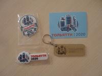 Отдается в дар Разное в коллекцию: магнит на холодильник, деревянный брелок, ручка с логотипом.