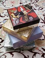 Отдается в дар 4 коробки от парфюмерных наборов