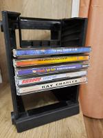 Отдается в дар CD, MP3 и этажерка для хранения