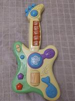 Отдается в дар игрушечная гитара
