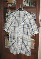 Отдается в дар Рубашка женская, р-р 56.