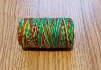 Отдается в дар Катушка меланжевых швейных ниток
