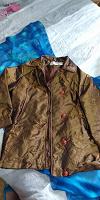 Отдается в дар Куртка женская 48 разм.