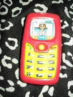 Отдается в дар сотовый телефон детям красный