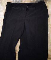 Отдается в дар Брюки женские чёрные 40-42 размер.