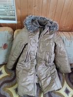 Отдается в дар пальто на девочку 146