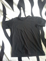 Отдается в дар футболка черная на подростка или девушку