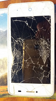 Отдается в дар Разбитый телефон на запчасти?
