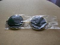 Отдается в дар очки солнечные (базилио)